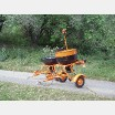 Fertilizer spreader for chemical treatment of vegetation